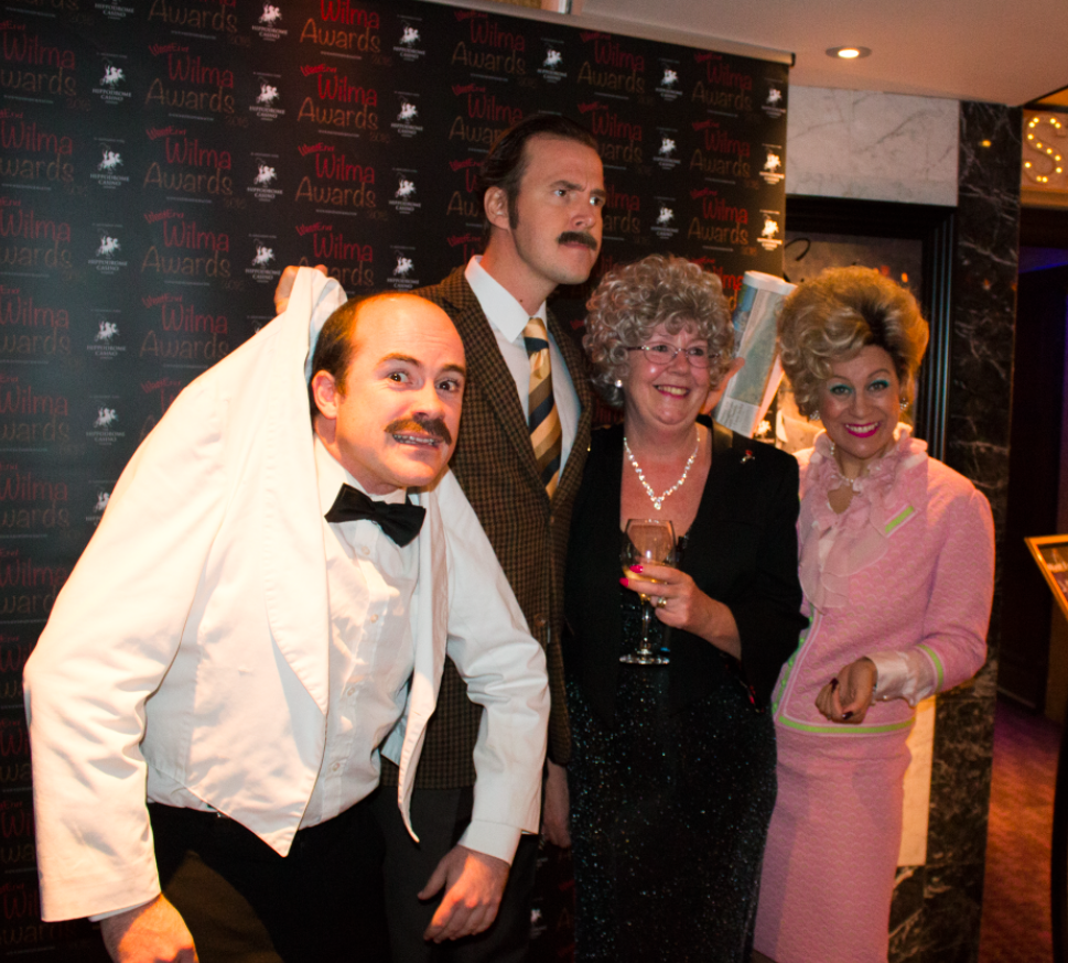 The cast of the Fawlty Towers Dining Experience join Wilma for a picture.