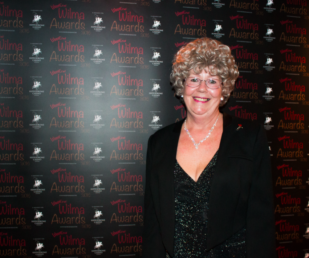 Wilma herself gives us a smile before the awards begin.
