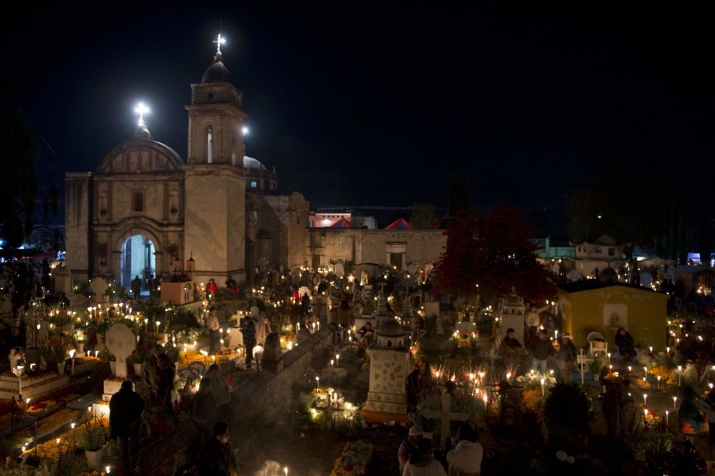 a festive cemetery on the Day of the Dead in 2012 in Tlacotepec, Puebla State, Mexico, photo credit Getty Images