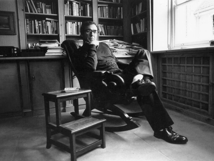 Playwright Harold Pinter (1930 - ) relaxing in his study. (Photo by Express Newspapers/Getty Images)