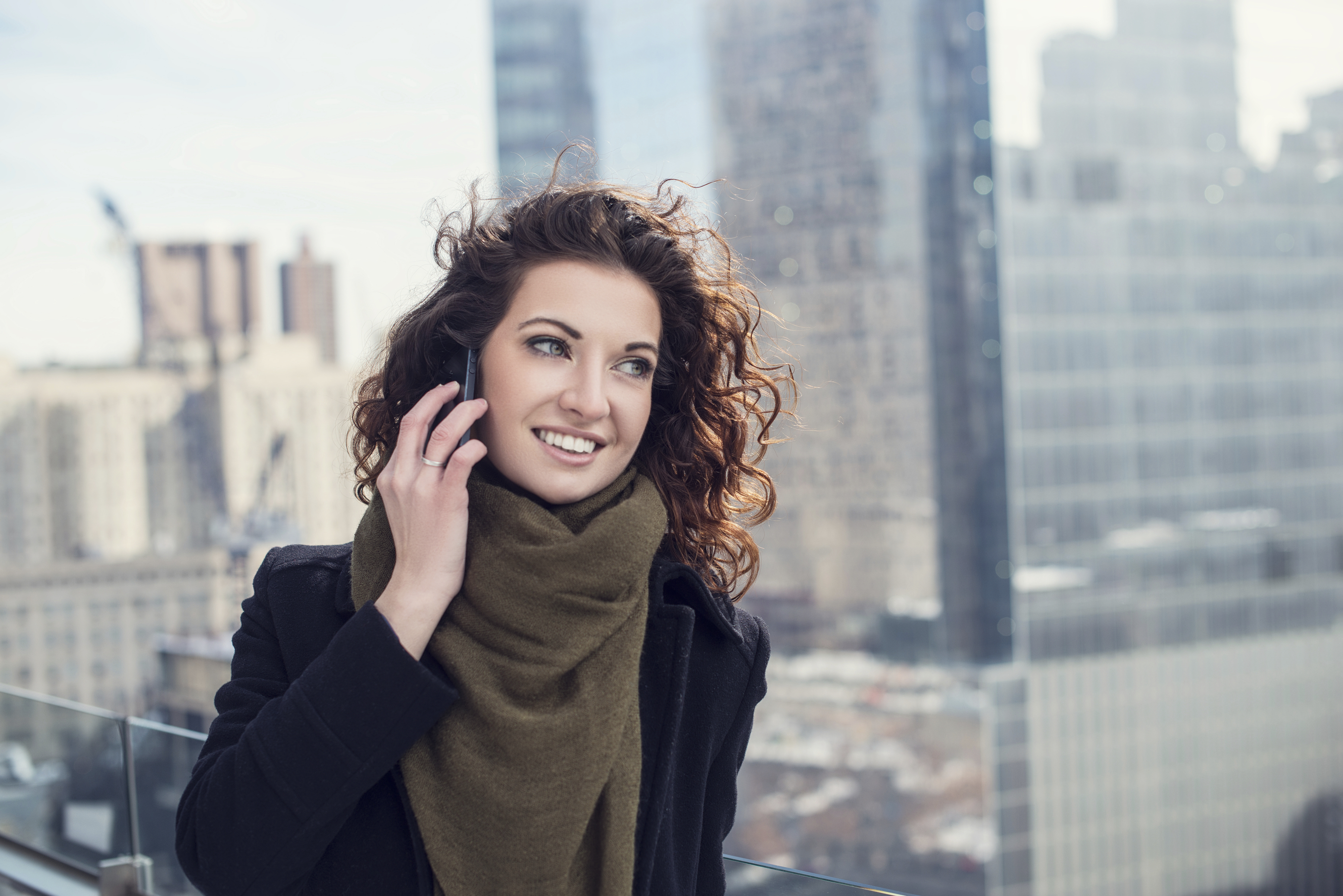 Young businesswoman talking on mobile phone