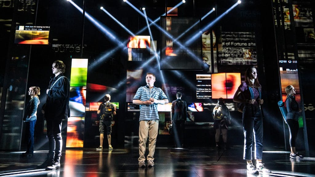 Dear Evan Actors standing in a circle onstage facing outward